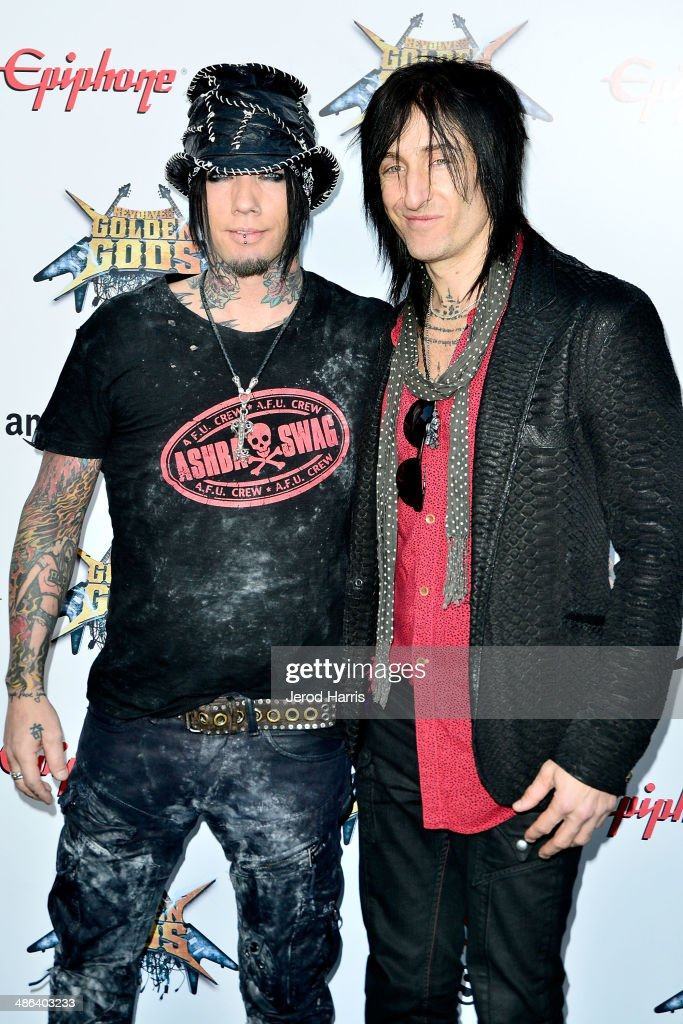 <a gi-track='captionPersonalityLinkClicked' href=/galleries/search?phrase=DJ+Ashba&family=editorial&specificpeople=2945709 ng-click='$event.stopPropagation()'>DJ Ashba</a> and Richard Fortus arrive at the 2014 Revolver Golden Gods Awards at Club Nokia on April 23, 2014 in Los Angeles, California.