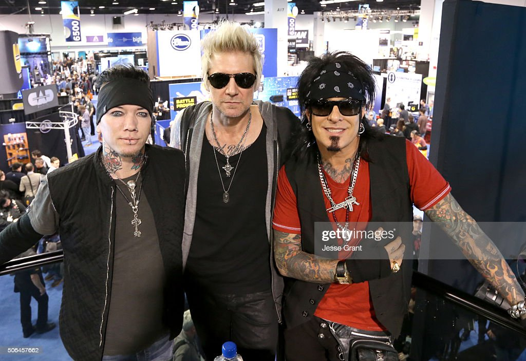 Ashba James Michael and Nikki Sixx of SixxAM attend day 3 of the 2016 NAMM Show at the Anaheim Convention Center on January 23 2016 in Anaheim...