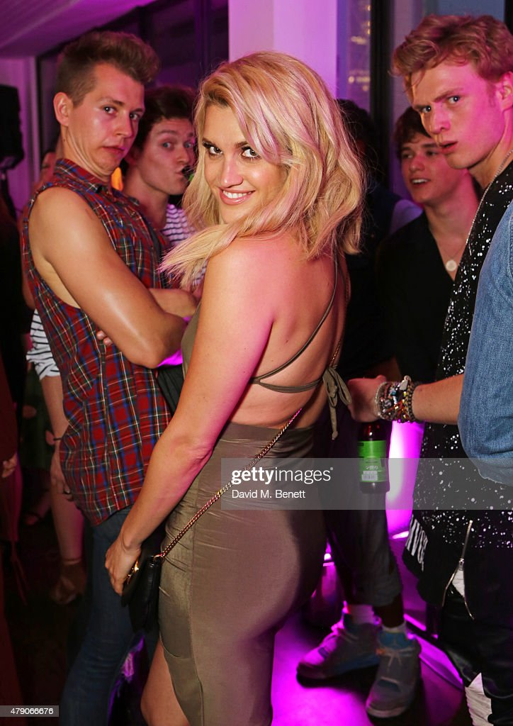 Ashely Roberts poses in front of James McVey Connor Ball Bradley Simpson and Tristan Evans of The Vamps at the Emporio Armani Diamonds Fragrance...