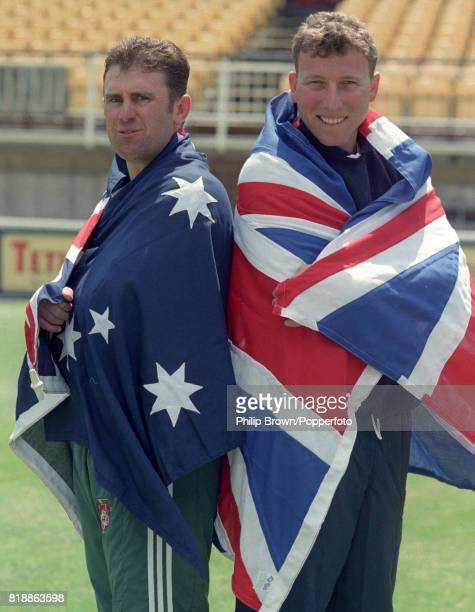 Ashes captains Mark Taylor of Australia and Mike Atherton of England pose for photos in their respective flags before the 1st Test match between...