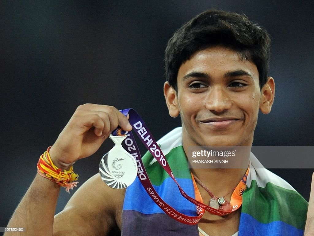<b>Ashish kumar</b> of India poses during the medal ceremony after winning silver <b>...</b> - ashish-kumar-of-india-poses-during-the-medal-ceremony-after-winning-picture-id107852490