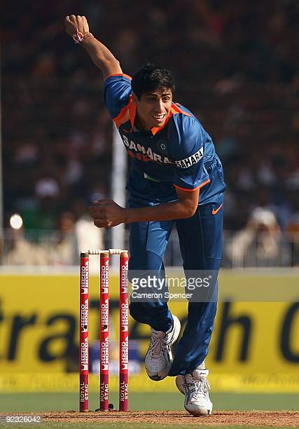 Ashish Nehra of India bowls during the first One Day International match between India and Australia at Reliance Stadium on October 25 2009 in...