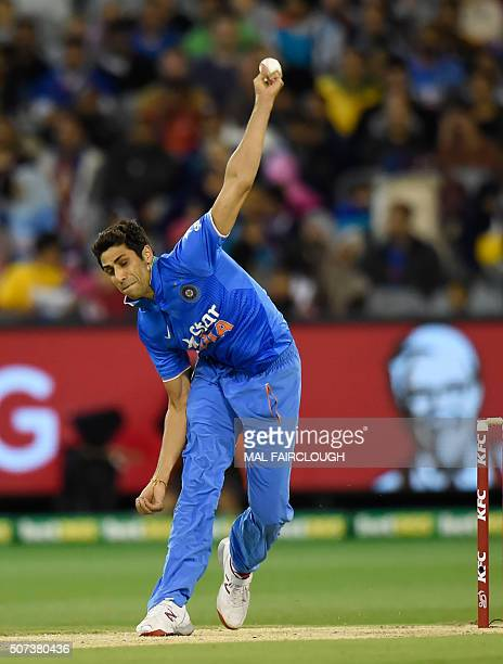Ashish Nehra of India bowls during the second Twenty20 international cricket match between Australia and India at the MCG in Melbourne on January 29...