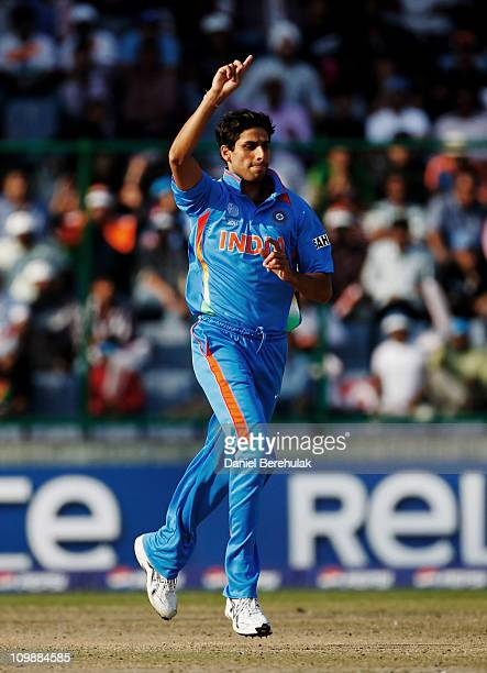 Ashish Nehra of India celebrates after taking the wicket of Tom Cooper of the Netherlands during the 2011 ICC Cricket World Cup Group B match between...