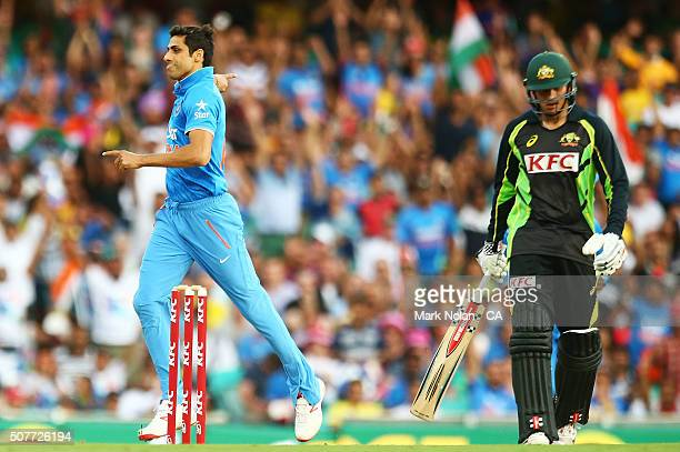 Ashish Nehra of India celebrates the wicket of Usman Khawaja during the International Twenty20 match between Australia and India at Sydney Cricket...