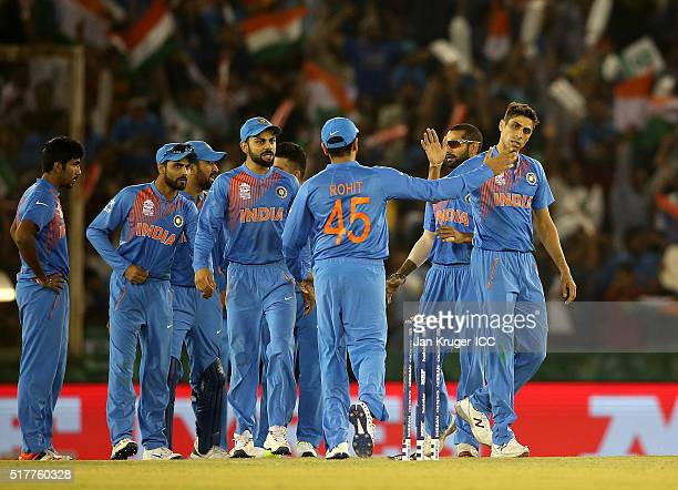 Ashish Nehra of India celebrates the wicket of Usman Khawaja of Australia with team mates during the ICC World Twenty20 India 2016 Super 10s Group 2...