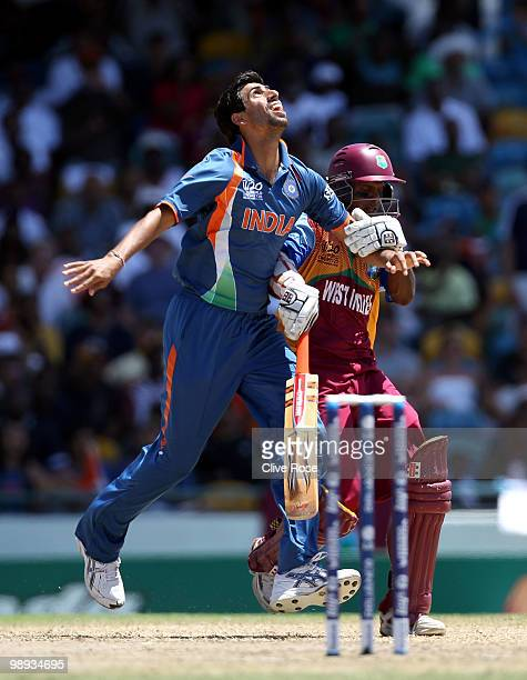 Ashish Nehra of India collides with Shivnarine Chanderpaul of West Indies during the ICC World Twenty20 Super Eight match between West Indies and...