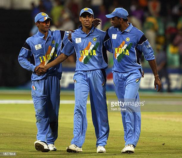 Ashish Nehra of India is congratulated by Mohammad Kaif and Javagal Srinath of India during the ICC Cricket World Cup 2003 Pool A match between...