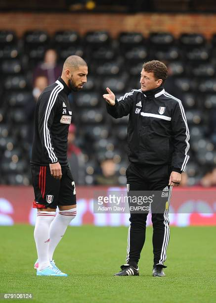 Ashkan Dejagah and Coach Billy McKinlay talk before the game