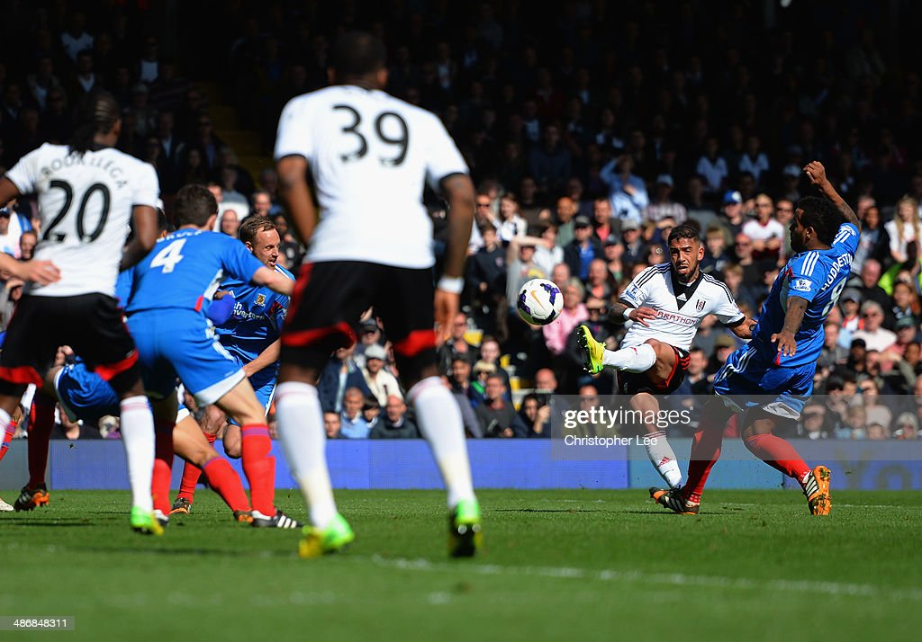 <a gi-track='captionPersonalityLinkClicked' href=/galleries/search?phrase=Ashkan+Dejagah&family=editorial&specificpeople=4024305 ng-click='$event.stopPropagation()'>Ashkan Dejagah</a> of Fulham scores their first goal during the Barclays Premier League match bewteen Fulham and Hull City at Craven Cottage on April 26, 2014 in London, England.
