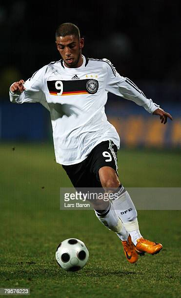 Ashkan Dejagah of Germany runs with the ball during the friendly match between U21 of Germany and U23 of Belgium at the Stadion Oberwerth on February...