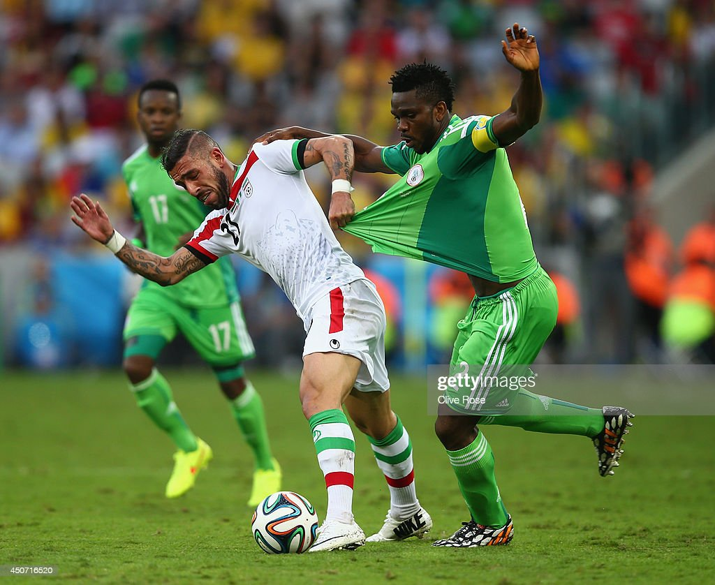 <a gi-track='captionPersonalityLinkClicked' href=/galleries/search?phrase=Ashkan+Dejagah&family=editorial&specificpeople=4024305 ng-click='$event.stopPropagation()'>Ashkan Dejagah</a> of Iran pulls the jersey of <a gi-track='captionPersonalityLinkClicked' href=/galleries/search?phrase=Joseph+Yobo&family=editorial&specificpeople=220395 ng-click='$event.stopPropagation()'>Joseph Yobo</a> of Nigeria during the 2014 FIFA World Cup Brazil Group F match between Iran and Nigeria at Arena da Baixada on June 16, 2014 in Curitiba, Brazil.