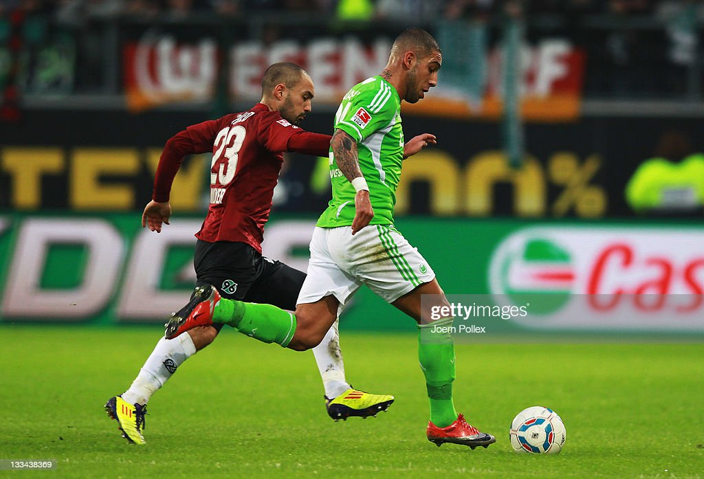Ashkan Dejagah of Wolfsburg and Sofian Chahed of Hannover battle for the ball during the Bundesliga match between VfL Wolfsburg and Hannover 96 at...