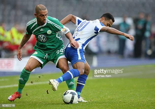 Ashkan Dejagah of Wolfsburg battles for the ball with Raffael of Berlin during the Bundesliga match between Hertha BSC Berlin and VFL Wolfsburg at...