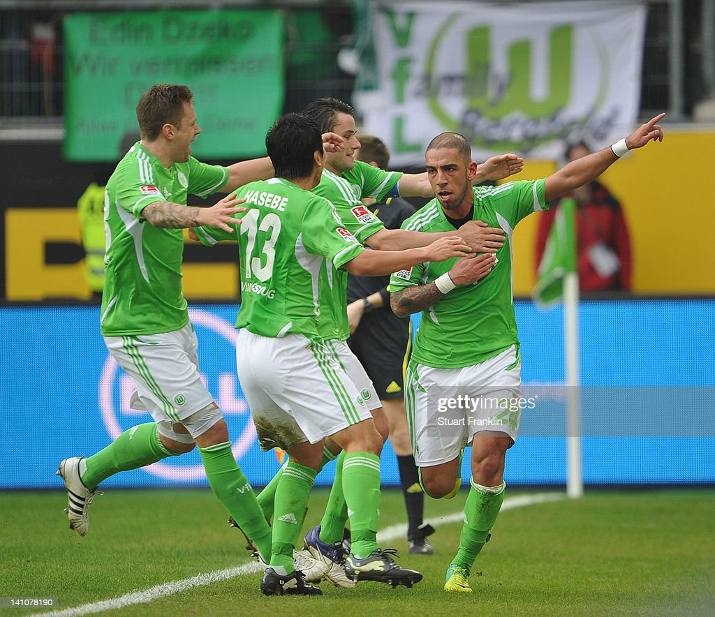 <a gi-track='captionPersonalityLinkClicked' href=/galleries/search?phrase=Ashkan+Dejagah&family=editorial&specificpeople=4024305 ng-click='$event.stopPropagation()'>Ashkan Dejagah</a> of Wolfsburg celebrates scoring his goal with teamates during the Bundesliga match between VfL Wolfsburg and Bayer 04 Leverkusen at Volkswagen Arena on March 10, 2012 in Wolfsburg, Germany.