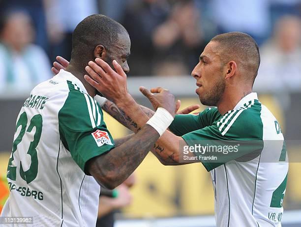 Ashkan Dejagah of Wolfsburg celebrates scoring the third goal with Grafite during the Bundesliga match between VfL Wolfsburg and 1 FC Koeln at...