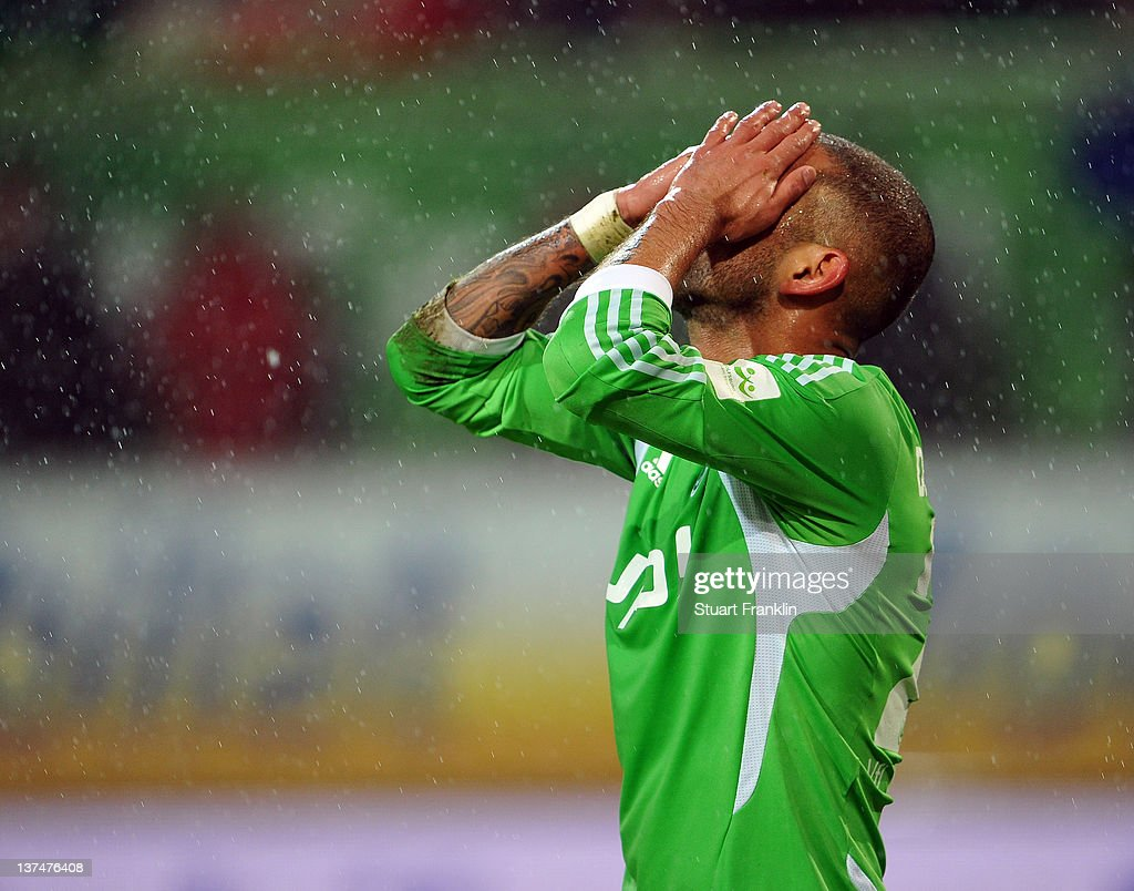 <a gi-track='captionPersonalityLinkClicked' href=/galleries/search?phrase=Ashkan+Dejagah&family=editorial&specificpeople=4024305 ng-click='$event.stopPropagation()'>Ashkan Dejagah</a> of Wolfsburg reacts to a missed chance during the Bundesliga match between VfL Wolfsburg and 1. FC Koeln at Volkswagen Arena on January 21, 2012 in Wolfsburg, Germany.