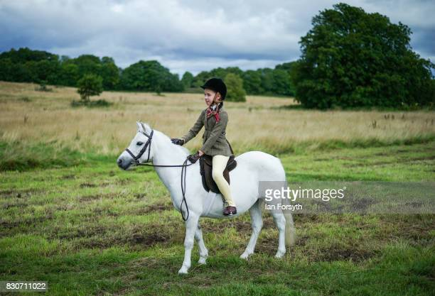 Ashlayne Wake 10 from Sunderland exercises her pony before competing during the 194th Sedgefield Show on August 12 2017 in Sedgefield England The...