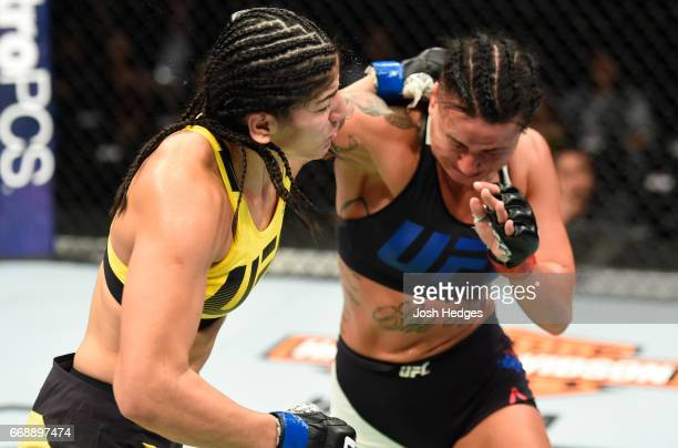 Ashlee EvansSmith exchanges punches with Ketlen Vieira of Brazil in their women's bantamweight fight during the UFC Fight Night event at Sprint...