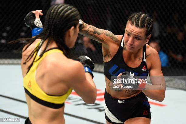 Ashlee EvansSmith punches Ketlen Vieira of Brazil in their women's bantamweight fight during the UFC Fight Night event at Sprint Center on April 15...