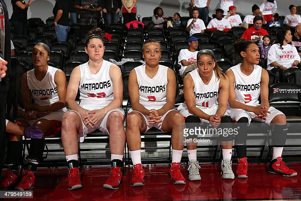 Ashlee Guay Mikayla Thielges Haley White Cinnamon Lister and Janae Sharpe of the Cal State Northridge Matadors sit on the bench as they wait to be...