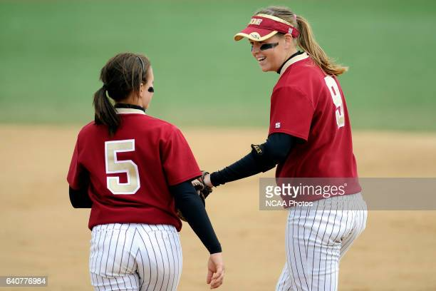 Ashlee Simon and Amy Hanse of Coe College strategize on the field during the Division III Women's Softball Championship held at the Montclair State...