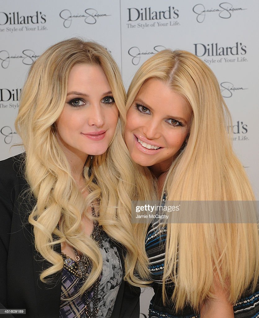Ashlee Simpson and Jessica Simpson both wearing Jessica Simpson Collection attend a Jessica Simpson Collection event at Dillard's on November 23 2013...