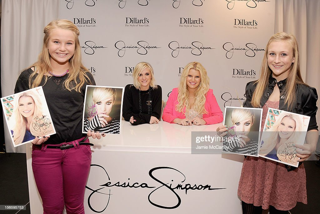 Ashlee Simpson and Jessica Simpson (center) pose with fans at Dillard's at International Plaza In Support Of the Jessica Simpson Collection on November 17, 2012 in Tampa, Florida.
