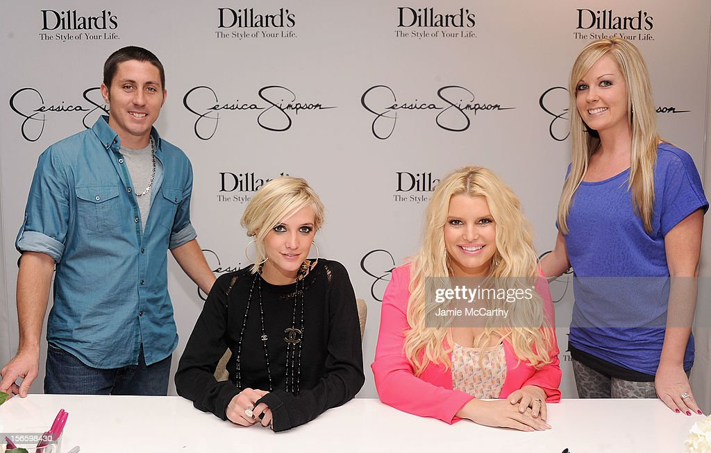 Ashlee Simpson and Jessica Simpson (center) pose with Ryan Martin and contest winner Jessica Martin at Dillard's at International Plaza In Support Of the Jessica Simpson Collection on November 17, 2012 in Tampa, Florida.