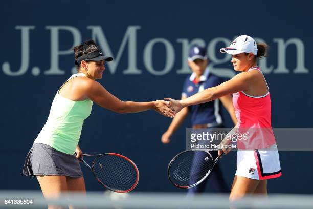 Ashleigh Barty and Casey Dellacqua of Australia react against Natela Dzalamidze and Veronika Kudermetova of Russia during their first round Women's...