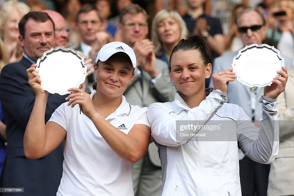 <a gi-track='captionPersonalityLinkClicked' href=/galleries/search?phrase=Ashleigh+Barty&family=editorial&specificpeople=7369424 ng-click='$event.stopPropagation()'>Ashleigh Barty</a> (L) and <a gi-track='captionPersonalityLinkClicked' href=/galleries/search?phrase=Casey+Dellacqua&family=editorial&specificpeople=575797 ng-click='$event.stopPropagation()'>Casey Dellacqua</a> of Australia smile as they pose with the runners-up trophies after their Ladies' Doubles final match against Shuai Peng of China and Su-Wei Hsieh of Taipei on day twelve of the Wimbledon Lawn Tennis Championships at the All England Lawn Tennis and Croquet Club on July 6, 2013 in London, England.