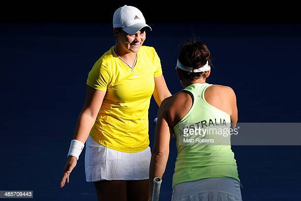 Ashleigh Barty celebrates a point with Casey Dellacqua of Australia in their doubles match against AnnaLena Groenefeld and Julia Goerges of Germany...