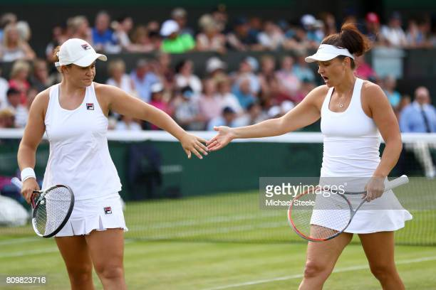 Ashleigh Barty of Australia and Casey Dellacqua of Australia celebrates a point during the Ladies Doubles first round match against Jelena Jankovic...