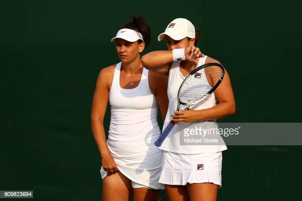 Ashleigh Barty of Australia and Casey Dellacqua of Australia in discussion during the Ladies Doubles first round match against Jelena Jankovic of...