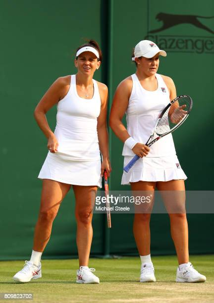 Ashleigh Barty of Australia and Casey Dellacqua of Australia look on during the Ladies Doubles first round match against Jelena Jankovic of Serbia...