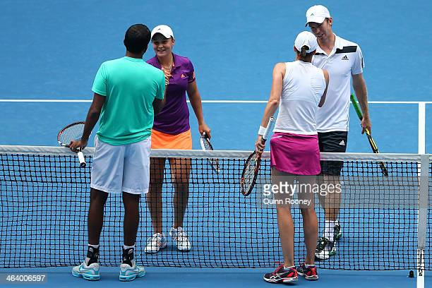 Ashleigh Barty of Australia and John Peers of Australia shakes hands with Katarina Srebotnik of Slovenia and Rohan Bopanna of Indiain after their...