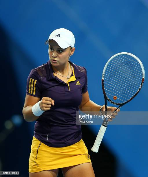 Ashleigh Barty of Australia celebrates winning a rally in her singles match against Francesca Schiavone of Italy during day six of the Hopman Cup at...
