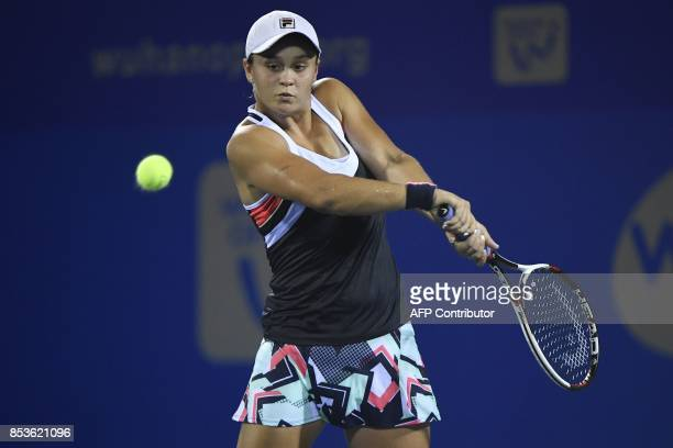 Ashleigh Barty of Australia hits a return against Johanna Konta of Great Britain during their first round women's match at the WTA Wuhan Open tennis...