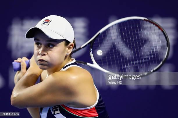 Ashleigh Barty of Australia hits a return in her match against Anastasia Pavlyuchenkova of Russia during the WTA Elite Trophy Zhuhai 2017 at Hengqin...