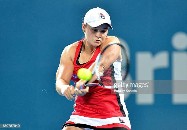 Ashleigh Barty of Australia plays a backhand against Aleksandra Krunic of Serbia on day two of the 2017 Brisbane International at Pat Rafter Arena on...