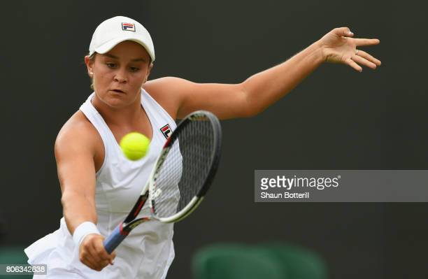 Ashleigh Barty of Australia plays a backhand during the Ladies Singles first round match on day one of the Wimbledon Lawn Tennis Championships at the...