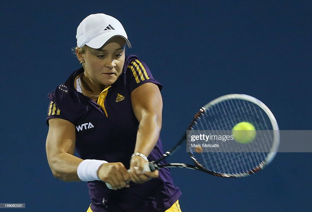 <a gi-track='captionPersonalityLinkClicked' href=/galleries/search?phrase=Ashleigh+Barty&family=editorial&specificpeople=7369424 ng-click='$event.stopPropagation()'>Ashleigh Barty</a> of Australia plays a backhand in her first round match against Mona Barthel of Germany during day four of the Hobart International at Domain Tennis Centre on January 7, 2013 in Hobart, Australia.