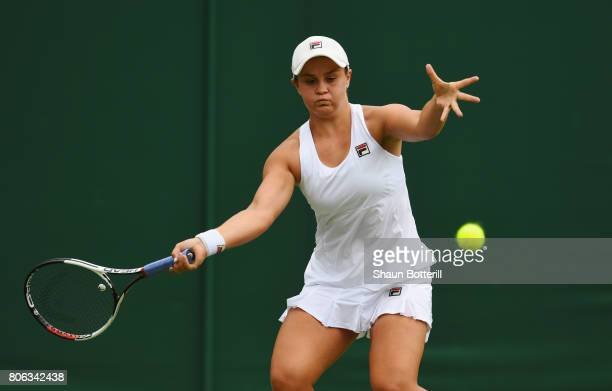 Ashleigh Barty of Australia plays a forehand during the Ladies Singles first round match on day one of the Wimbledon Lawn Tennis Championships at the...
