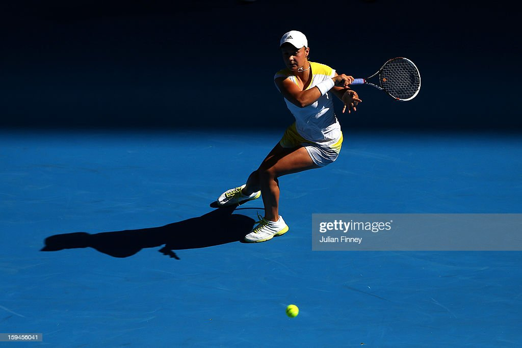 Ashleigh Barty of Australia plays a forehand in her first round match against Dominika Cibulkova of Slovakia during day one of the 2013 Australian Open at Melbourne Park on January 14, 2013 in Melbourne, Australia.