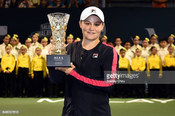 Ashleigh Barty of Australia poses with the WTA Malaysian Open Champion Trophy after she defeated Nao Hibino of Japan during the Final of the 2017 WTA...