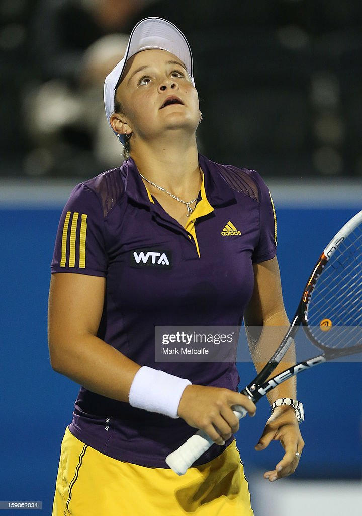 <a gi-track='captionPersonalityLinkClicked' href=/galleries/search?phrase=Ashleigh+Barty&family=editorial&specificpeople=7369424 ng-click='$event.stopPropagation()'>Ashleigh Barty</a> of Australia reacts to losing a point in her first round match against Mona Barthel of Germany during day four of the Hobart International at Domain Tennis Centre on January 7, 2013 in Hobart, Australia.
