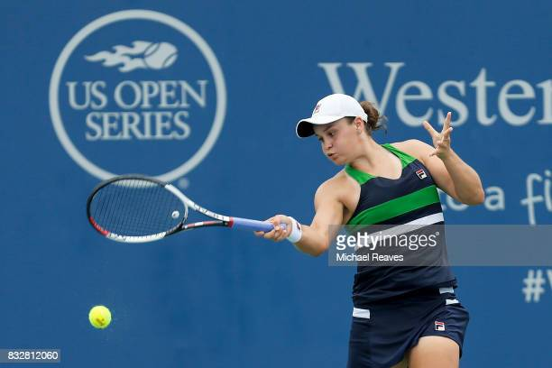 Ashleigh Barty of Australia returns a shot against Venus Williams of the United States during Day 5 of the Western and Southern Open at the Lindner...