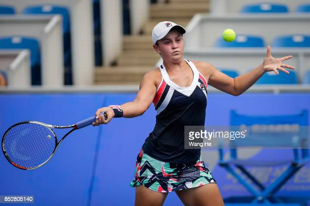 Ashleigh Barty of Australia returns a shot during the match against Catherine Bellis of USA on Day 1 of 2017 Dongfeng Motor Wuhan Open at Optics...