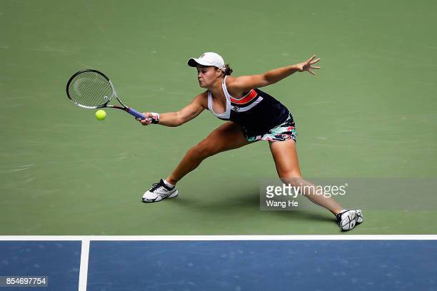 Ashleigh Barty of Australia returns a shot during the match against Agnieszka Redwanska of Poland in their match of Women's Single during Day 4 on...