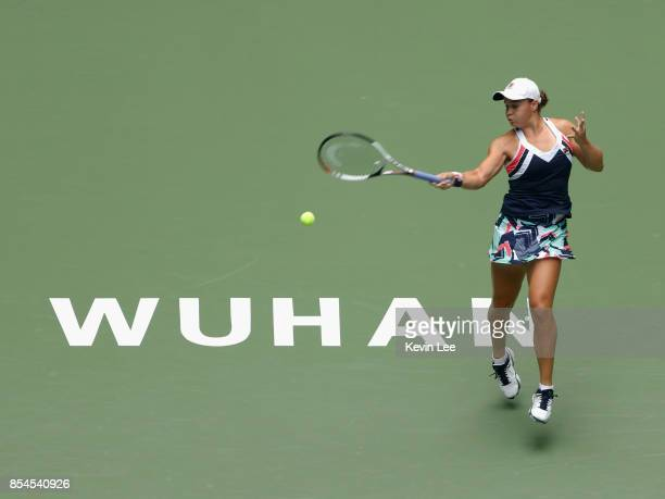 Ashleigh Barty of Australia returns a shot to Agnieszka Radwanska of Poland in their round 3 match of Women's Single during Day 4 on September 27...